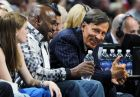 E. Stanley Kroenke, third from front, owner of the Denver Nuggets, talks with fans in courtside seats as the Nuggets host the Los Angeles Lakers in the first quarter of Game 3 of the teams' first-round NBA playoff series in Denver on Friday, May 4, 2012. (AP Photo/David Zalubowski)