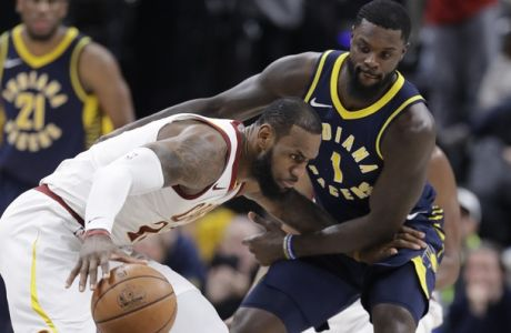 Cleveland Cavaliers' LeBron James (23) is defended by Indiana Pacers' Lance Stephenson during the second half of an NBA basketball game, Friday, Jan. 12, 2018, in Indianapolis. (AP Photo/Darron Cummings)