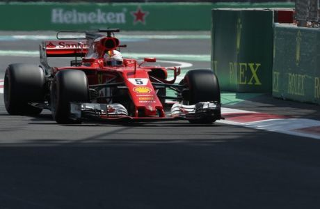 Ferrari driver Sebastian Vettel, of Germany, steers his car during qualifiers for the Formula One Mexico Grand Prix auto race at the Hermanos Rodriguez racetrack in Mexico City, Saturday, Oct. 28, 2017.  (AP Photo/Moises Castillo)