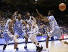 Duke's RJ Barrett (5) struggles for possession with North Carolina's Kenny Williams (24), Garrison Brooks (15) and Brandon Robinson, right, during the second half of an NCAA college basketball game in Durham, N.C., Wednesday, Feb. 20, 2019. North Carolina won 88-72. (AP Photo/Gerry Broome)