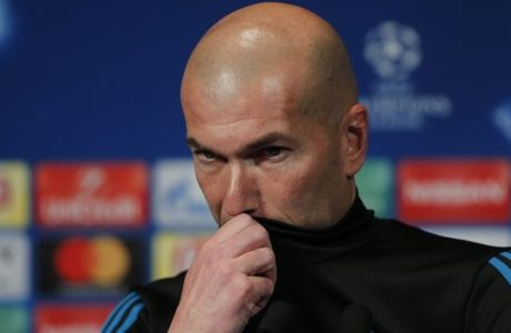Real Madrid's head coach Zinedine Zidane pauses during a press conference at the Parc des Princes Stadium in Paris, France, Monday, March 5, 2018. Real Madrid will play Paris Saint-Germain Tuesday in a Champions League, round of 16, 2nd leg soccer match. (AP Photo/Thibault Camus)