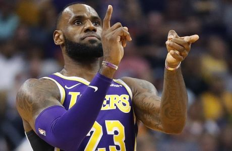 Los Angeles Lakers forward LeBron James (23) celebrates a basket against the Phoenix Suns during the second half of an NBA basketball game, Wednesday, Oct. 24, 2018, in Phoenix. (AP Photo/Matt York)