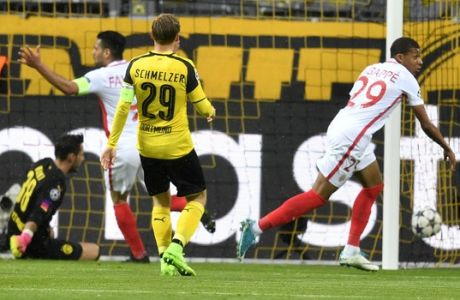 Monaco's Kylian Mbappe, right, celebrates after scoring the opening goal during the Champions League quarterfinal first leg soccer match between Borussia Dortmund and AS Monaco in Dortmund, Germany, Wednesday, April 12, 2017. (AP Photo/Martin Meissner)