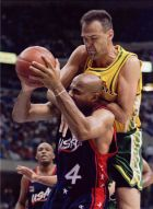 CLE03:SPORTS-BASKETBALL:CLEVELAND,OHIO7JUL96- Oscar Schmidt of Brazil fouls Charles Barkley of the United States during their international match in Cleveland on July 7, 1996. Schmidt, who played in five Olympic Games, announced his retirement May 25, 2003 at the age of 45. He took part in every Olympic Games from Moscow in 1980 to Atlanta in 1996, scoring a total of 1,093 points. In 2001, Schmidt surpassed NBA legend Kareem Abdul-Jabbar's career record of 46,725 points. The highlight of his career came in 1987 when he was in the Brazil team that stunned the United States to win the gold medal at the Pan-Am Games in Indianapolis.  REUTERS/Ron Kuntz/FILE (Newscom TagID: rtrlive495297.jpg) [Photo via Newscom]