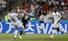 Uruguay's Edinson Cavani, center, shots on goal beside Portugal's Pepe, left, and Portugal's Ricardo during the round of 16 match between Uruguay and Portugal at the 2018 soccer World Cup at the Fisht Stadium in Sochi, Russia, Saturday, June 30, 2018. (AP Photo/Francisco Seco)