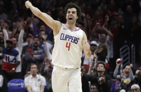 Los Angeles Clippers' Milos Teodosic celebrates his three-point basket during the second half of an NBA basketball game against the Toronto Raptors, Monday, Dec. 11, 2017, in Los Angeles. The Clippers won 96-91. (AP Photo/Jae C. Hong)