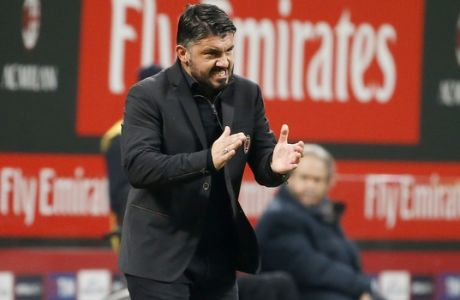 AC Milan coach Gennaro Gattuso gives instructions during the Italian Cup soccer match between AC Milan and Hellas Verona at the San Siro stadium in Milan, Italy, Thursday, Dec. 14, 2017. (AP Photo/Antonio Calanni)