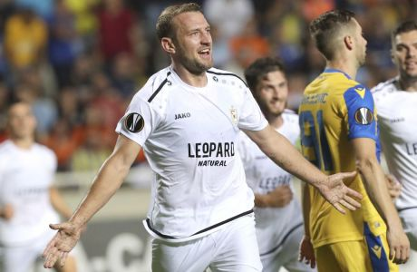 Dudelange's Dominik Stolz celebrates his goal against APOEL during the Europa League group A soccer match between APOEL Nicosia and Dudelange at GSP stadium in Nicosia, Cyprus, Thursday, Sept. 19, 2019. (AP Photo/Petros Karadjias)
