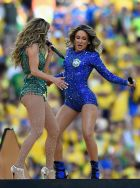 SAO PAULO, BRAZIL - JUNE 12:  Singers Jennifer Lopez (L) and Claudia Leitte perform during the Opening Ceremony of the 2014 FIFA World Cup Brazil prior to the Group A match between Brazil and Croatia at Arena de Sao Paulo on June 12, 2014 in Sao Paulo, Brazil.  (Photo by Buda Mendes/Getty Images)