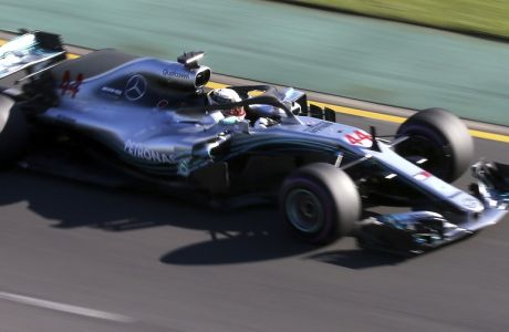 Mercedes driver Lewis Hamilton of Britain drives trough turn 2 during the second practice session at the Australian Formula One Grand Prix in Melbourne, Friday, March 23, 2018. The first race of the 2018 seasons is on Sunday. (AP Photo/Rick Rycroft)