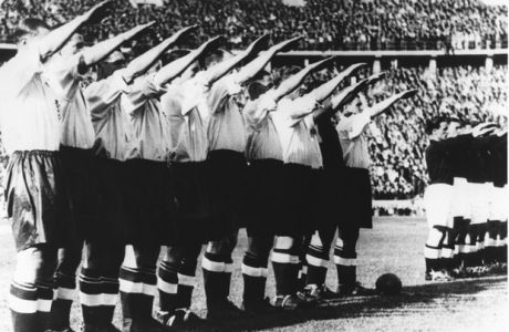 Before a record crowd of over one hundred thousand people who filled the Olympic stadium to capacity, the English football team give the Nazi salute in this May 14th, 1938, file photo. England beat Germany 6-3. (AP PHOTO).
