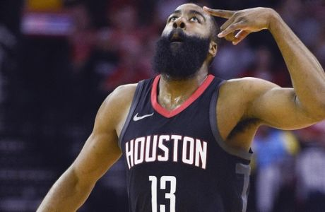 Houston Rockets guard James Harden reacts after making a 3-pointer during the first half of an NBA basketball game against the Phoenix Suns, Sunday, Jan. 28, 2018, in Houston. (AP Photo/Eric Christian Smith)