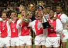 European champion Ajax players show off their trophies after winning Toyota Cup match in Tokyo Tuesday night, Nov. 28, 1995 to decide world's No.1 soccer club. From left are, Danny Blind (3), Marc Overmars (11), Ronald De Boer (6), Edgar Davids (8), Patrick Kluivert (9) and Winston Bogarde (5). (AP Photo/Itsuo Inouye)