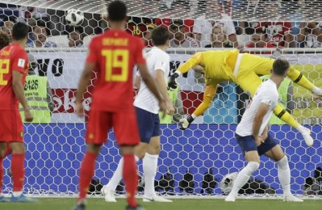 England goalkeeper Jordan Pickford dives but fails to prevent Belgium from scoring their side's first goal during the group G match between England and Belgium at the 2018 soccer World Cup in the Kaliningrad Stadium in Kaliningrad, Russia, Thursday, June 28, 2018. (AP Photo/Petr David Josek)