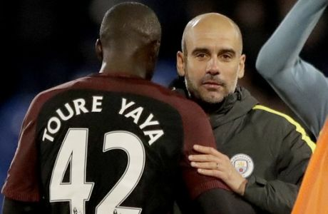 Manchester City's Yaya Toure, who scored both their goals, celebrates with his head coach Pep Guardiola after the English Premier League soccer match between Crystal Palace and Manchester City at Selhurst Park stadium in London, Saturday, Nov. 19, 2016. (AP Photo/Matt Dunham)