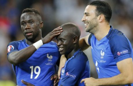 France's Bacary Sagna, N'Golo Kante and Adil Rami, from left, celebrate after winning 2-0 during the Euro 2016 semifinal soccer match between Germany and France, at the Velodrome stadium in Marseille, France, Thursday, July 7, 2016. (AP Photo/Michael Probst)