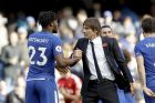 Chelsea head coach Antonio Conte congratulates double-goal scorer Chelsea's Michy Batshuayi after the English Premier League soccer match between Chelsea and Watford at Stamford Bridge stadium in London, Saturday, Oct. 21, 2017. (AP Photo/Matt Dunham)