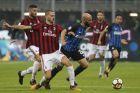 AC Milan's Leonardo Bonucci challenges Inter Milan's Borja Valero, right, during the Serie A soccer match between Inter Milan and AC Milan, at the Milan San Siro Stadium, Italy, Sunday, Oct. 15, 2017. (AP Photo/Antonio Calanni)