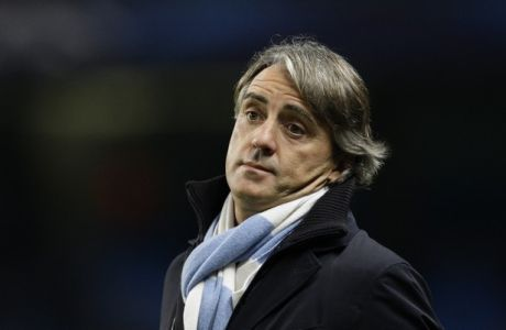 Manchester City's manager Roberto Mancini takes to the touchline before his team's Champions League Group D soccer match against Real Madrid at the Etihad Stadium, Manchester, England, Wednesday Nov. 21, 2012. (AP Photo/Jon Super)