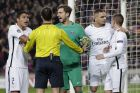 PSG' players argue with the referee Deniz Ayetekin during the Champions League round of 16, second leg soccer match between FC Barcelona and Paris Saint Germain at the Camp Nou stadium in Barcelona, Spain, Wednesday March 8, 2017. (AP Photo/Emilio Morenatti)