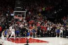 Portland Trail Blazers guard Damian Lillard, right, watches as his final-seconds three-point basket attempt falls short during overtime in Game 4 of the NBA basketball playoffs Western Conference finals against the Golden State Warriors, Monday, May 20, 2019, in Portland, Ore. The Warriors won 119-117 in overtime. (AP Photo/Ted S. Warren)