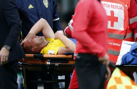 Sweden's Jakob Johansson is carried off the pitch on a stretcher during the World Cup qualifying play-off second leg soccer match between Italy and Sweden, at the Milan San Siro stadium, Italy, Monday, Nov. 13, 2017. (AP Photo/Antonio Calanni)
