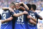 Hoffenheim's Nico Schulz, second left, celebrates with scorer  Mark Uth, center, and other teammates during the German Bundesliga soccer match between TSG 1899 Hoffenheim and 1. FC Cologne in Sinsheim, Germany, Saturday, March 31, 2018 (Uwe Anspach/dpa via AP)