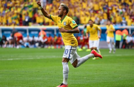 BRASILIA, BRAZIL - JUNE 23:  Neymar of Brazil celebrates after scoring his team's first goal during the 2014 FIFA World Cup Brazil Group A match between Cameroon and Brazil at Estadio Nacional on June 23, 2014 in Brasilia, Brazil.  (Photo by Clive Brunskill/Getty Images)