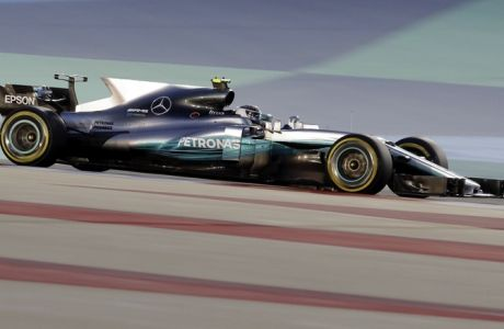 Mercedes driver Valtteri Bottas of Finland steers his car during the qualifying session for the Bahrain Formula One Grand Prix, at the Formula One Bahrain International Circuit in Sakhir, Bahrain, Saturday, April 15, 2017. The Bahrain Formula One Grand Prix will take place on Sunday. (AP Photo/Luca Bruno)
