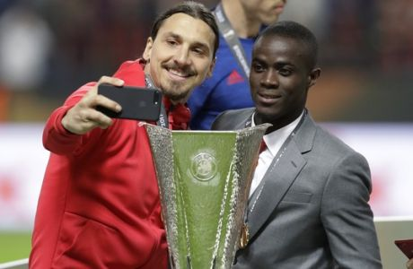 Manchester's injured player Zlatan Ibrahimovic takes a selfie after winning 2-0 during the soccer Europa League final between Ajax Amsterdam and Manchester United at the Friends Arena in Stockholm, Sweden, Wednesday, May 24, 2017. (AP Photo/Michael Sohn)