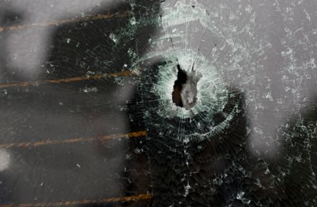 A bullet hole scars the back window of the car in which a Spanish tourist was shot dead by military police, at a police station in Rio de Janeiro, Brazil, Tuesday, Oct. 24, 2017. Brazilian military police say officers killed a Spanish tourist when the vehicle she was travelling in came under fire after ignoring a police checkpoint. A military police statement says the incident followed a firefight between police officers and suspected drug traffickers early Monday in Rocinha, one of Brazil's largest slums. (AP Photo/Silvia Izquierdo)