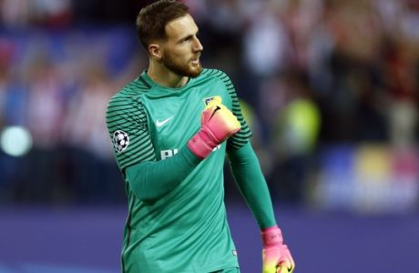 FILE - In this Wednesday, April 12, 2017 file photo, Atletico goalkeeper Jan Oblak celebrates after teammate Antoine Griezmann scoring the opening goal during the Champions League quarterfinal first leg soccer match between Atletico Madrid and Leicester City at the Vicente Calderon stadium in Madrid. The Champions League semifinals begin this week with Spanish rivals Real Madrid and Atletico Madrid meeting for the fourth consecutive time in the European competition, while surprising French club Monaco will try to keep Italian champion Juventus from returning to the final for the second time in three seasons. (AP Photo/Francisco Seco, File)