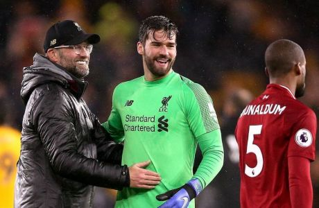 Wolverhampton Wanderers v Liverpool - Premier League - Molineux Liverpool manager Jurgen Klopp (left) goalkeeper Alisson Becker and Georginio Wijnaldum celebrate after the final whistle EDITORIAL USE ONLY No use with unauthorised audio, video, data, fixture lists, club/league logos or live services. Online in-match use limited to 120 images, no video emulation. No use in betting, games or single club/league/player publications. PUBLICATIONxINxGERxSUIxAUTxONLY Copyright: xNigelxFrenchx 40326300