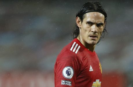 Manchester United's Edinson Cavani reacts during the English Premier League soccer match between Manchester United and Chelsea, at the Old Trafford stadium in Manchester, England, Saturday, Oct. 24, 2020. (Phil Noble/Pool via AP)