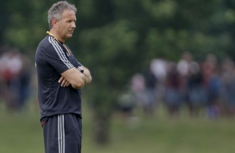 AC Milan coach Sinisa Mihajlovic stands on the pitch during a training session at the Milanello center in Carnago, near Milan, Italy, Friday, July 3, 2015. AC Milan president Silvio Berlusconi has demanded new coach Sinisa Mihajlovic lead the club back into the Champions League. (AP Photo/Luca Bruno)