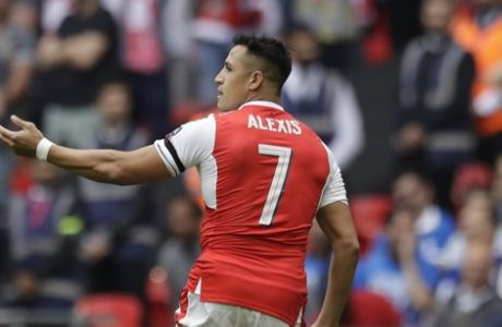 Arsenal's Alexis Sanchez celebrates after scoring the opening goal during the English FA Cup final soccer match between Arsenal and Chelsea at the Wembley stadium in London, Saturday, May 27, 2017. (AP Photo/Matt Dunham)