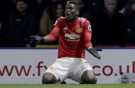 Manchester United's Paul Pogba reacts in frustration during the English Premier League soccer match between Watford and Manchester United at Vicarage Road stadium in Watford, England, Tuesday, Nov. 28, 2017. (AP Photo/Matt Dunham)