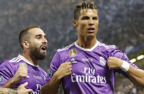 Real Madrid's Cristiano Ronaldo, right, celebrates after scoring the opening goal during the Champions League final soccer match between Juventus and Real Madrid at the Millennium stadium in Cardiff, Wales Saturday June 3, 2017. (AP Photo/Frank Augstein)