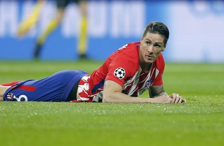 Atletico's Fernando Torres lies on the pitch during a Champions League group C soccer match between Atletico Madrid and Roma at the Wanda Metropolitano stadium in Madrid, Wednesday, Nov. 22, 2017. (AP Photo/Paul White)