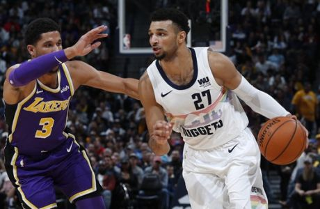 Denver Nuggets guard Jamal Murray, right drives past Los Angeles Lakers guard Josh Hart during the second half of an NBA basketball game Tuesday, Nov. 27, 2018, in Denver. The Nuggets won 117-85. (AP Photo/David Zalubowski)