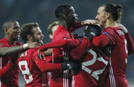 Manchester United's from left, Eric Bailly, Juan Mata, Paul Pogba, Henrikh Mkhitaryan and Zlatan Ibrahimovic celebrate after their first goal during the Europa League group A soccer match between Manchester United and Zorya Luhansk at Chornomorets stadium in Odessa, Ukraine, Thursday, Dec. 8, 2016. (AP Photo/Efrem Lukatsky)