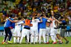 FORTALEZA, BRAZIL - JUNE 24:  Greece players celebrate the 2-1 win after the 2014 FIFA World Cup Brazil Group C match between Greece and Cote D'Ivoire at Estadio Castelao on June 24, 2014 in Fortaleza, Brazil.  (Photo by Alex Livesey - FIFA/FIFA via Getty Images)