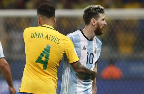 Brazil's Dani Alves (4) greets Argentina's Lionel Messi after a 2018 World Cup qualifying soccer match at the Estadio Mineirao in Belo Horizonte, Brazil, Thursday Nov. 10, 2016. Brazil won the match 3-0.(AP Photo/Leo Correa)