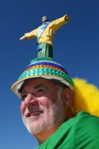 SAO PAULO, BRAZIL - JUNE 12: A fan poses with a Christ the Redeemer statue replica hat before the Opening Ceremony of the 2014 FIFA World Cup Brazil prior to the Group A match between Brazil and Croatia at Arena de Sao Paulo on June 12, 2014 in Sao Paulo, Brazil.  (Photo by Kevin Cox/Getty Images)