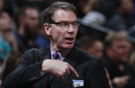 Former team executive Kiki Vandeweghe talks to fans on way to seat to watch the Los Angeles Lakers face the Denver Nuggets in the third quarter of the Nuggets' 134-126 victory in an NBA basketball game in Denver on Friday, March 7, 2014. (AP Photo/David Zalubowski)