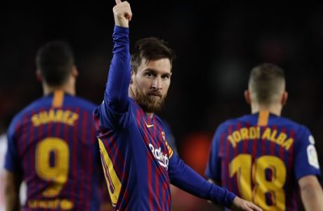 FC Barcelona's Lionel Messi, centre, celebrates after scoring his side's second goal during the Spanish La Liga soccer match between FC Barcelona and Eibar at the Camp Nou stadium in Barcelona, Spain, Sunday, Jan. 13, 2019. (AP Photo/Manu Fernandez)