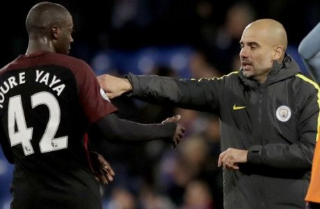 Manchester City's Yaya Toure, who scored both their goals, left, celebrates with his head coach Pep Guardiola after the English Premier League soccer match between Crystal Palace and Manchester City at Selhurst Park stadium in London, Saturday, Nov. 19, 2016. (AP Photo/Matt Dunham)
