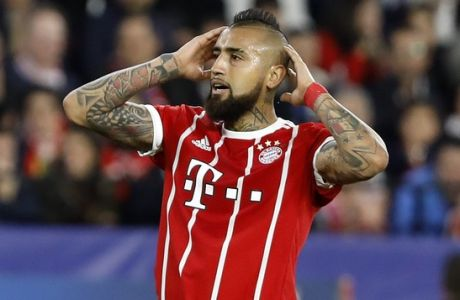 Bayern's Arturo Vidal reacts during the Champions League quarter final first leg soccer match between Sevilla FC and FC Bayern Munich at the Sanchez Pizjuan stadium in Seville, Spain, Tuesday, April 3, 2018. (AP Photo/Miguel Morenatti)