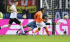 Netherlands' Donyell Malen, center, scores his side's third goal past Germany goalkeeper Manuel Neuer during the Euro 2020 group C qualifying soccer match between Germany and the Netherlands at the Volksparkstadion in Hamburg, Germany, Friday, Sept. 6, 2019. (AP Photo/Martin Meissner)