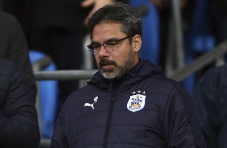 Huddersfield's team manager David Wagner arrives in the stands for the English FA Cup soccer match between Manchester City and Huddersfield Town at the Etihad stadium in Manchester, Wednesday, March 1, 2017.(AP Photo/Dave Thompson)